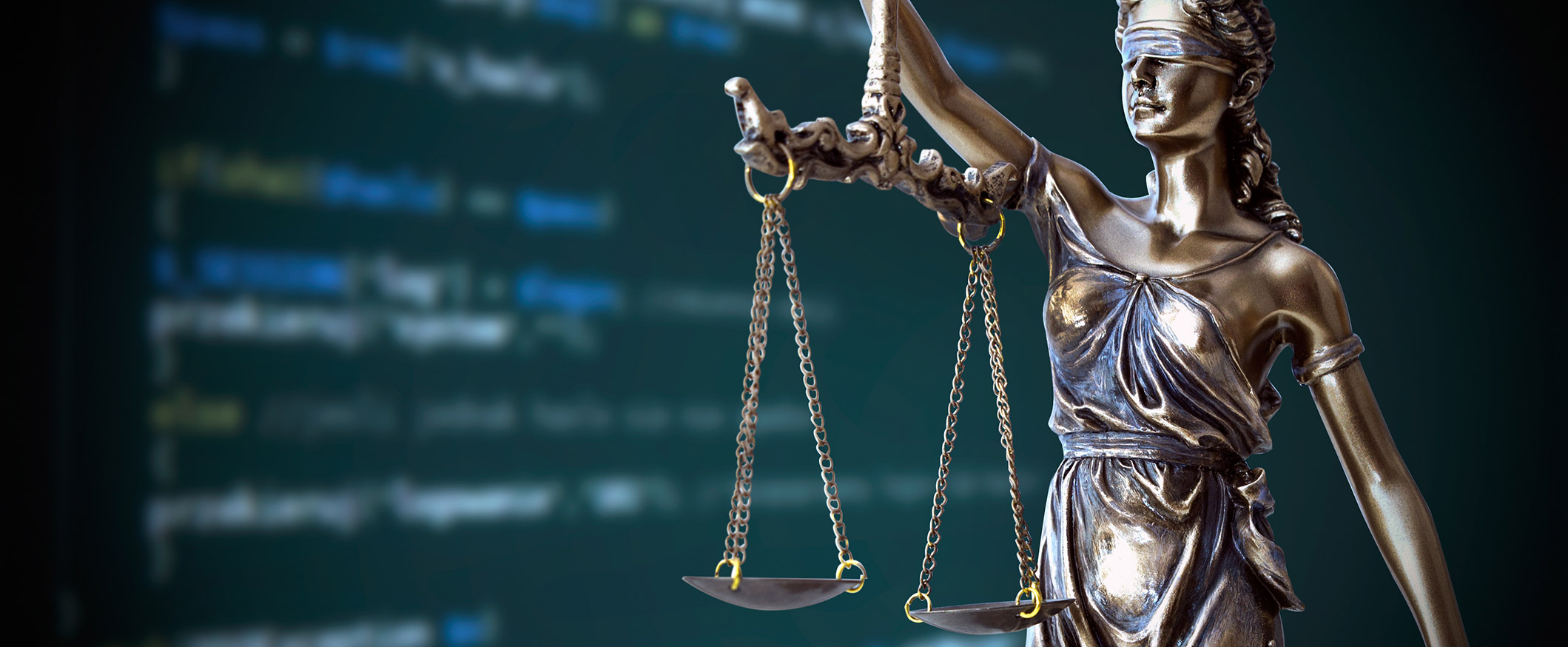 Lady Justice in front of monitor displaying HTML